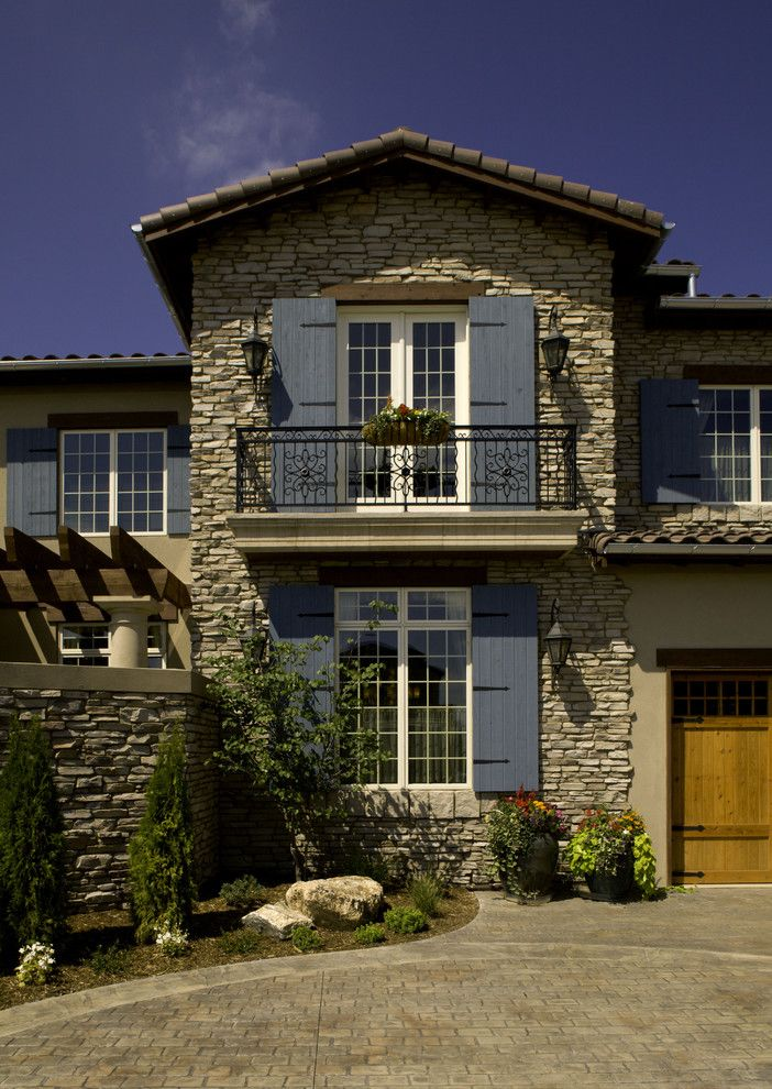 Conex Box Homes for a Mediterranean Exterior with a Stacked Stone and 2008 Parade of Homes House by Lawrence Architecture, Inc.