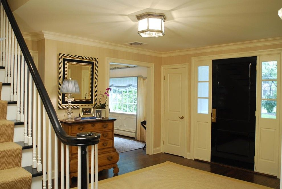 Connells Furniture for a Traditional Entry with a Books and a Family Affair: Curb Appeal by Jennifer Connell Design
