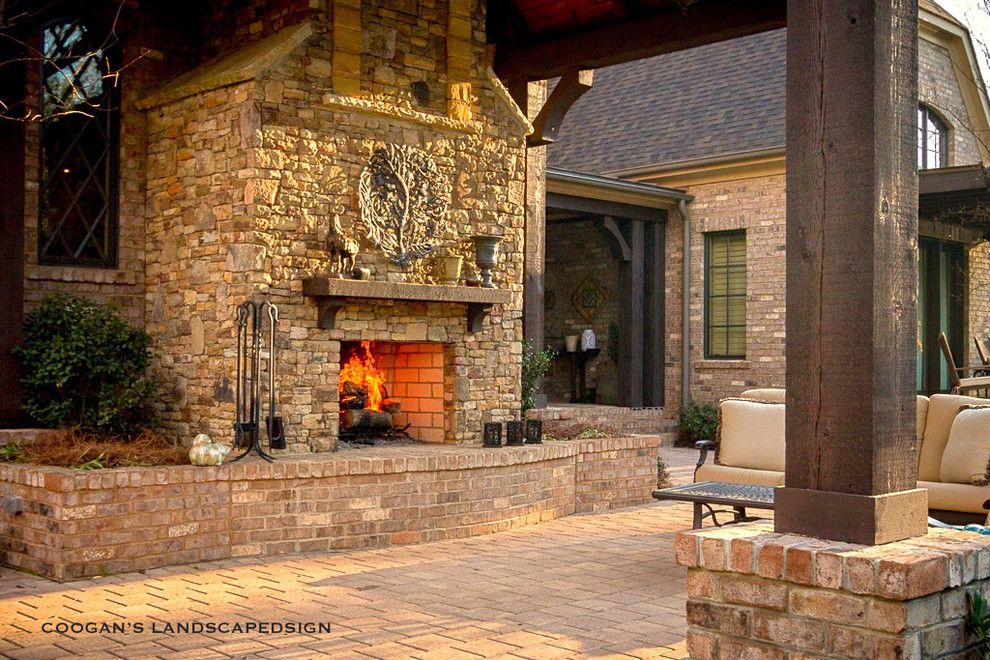 Coogans for a Midcentury Porch with a Paver Patio and Outdoor Fireplaces by Coogan's Landscape Design