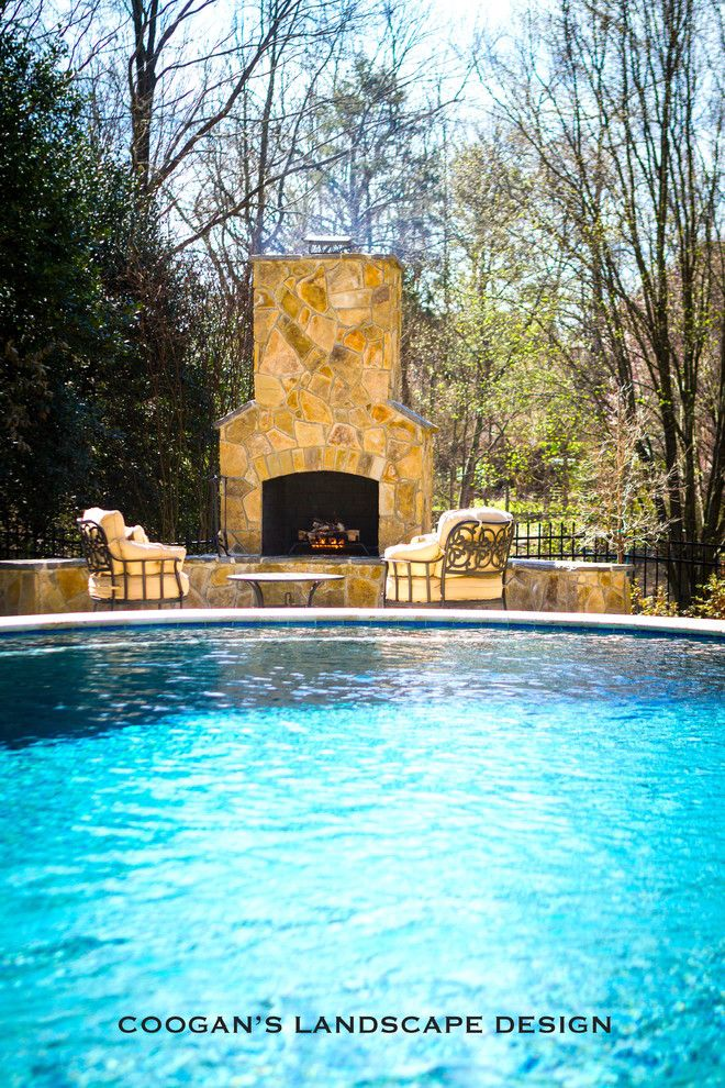 Coogans for a  Patio with a Holly Bushes and Outdoor Fireplaces by Coogan's Landscape Design