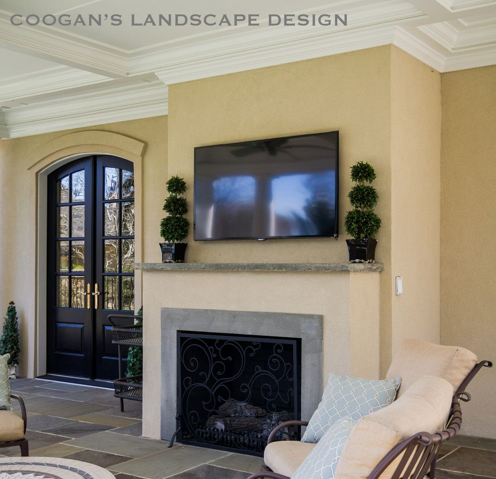 Coogans for a  Spaces with a Covered Porch and Outdoor Fireplaces by Coogan's Landscape Design