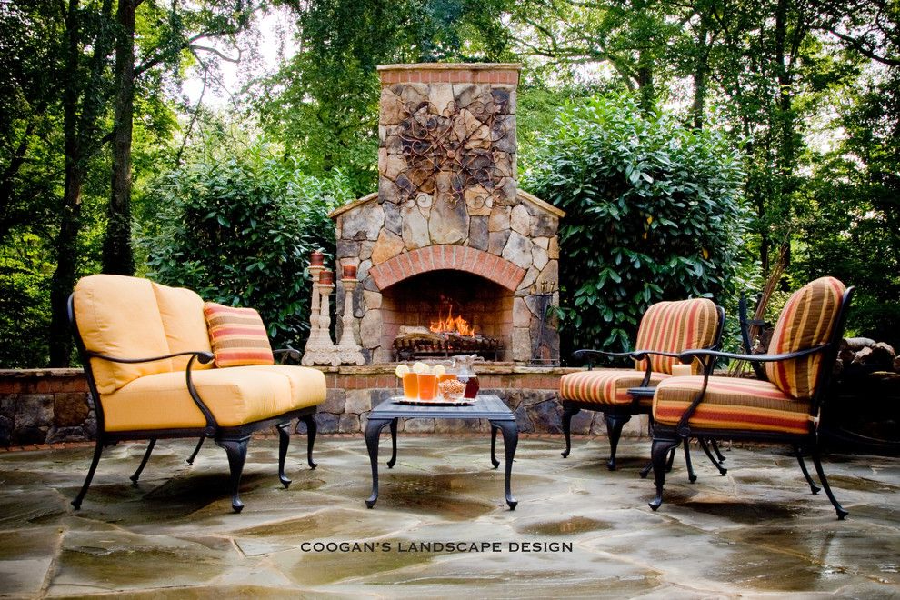 Coogans for a  Spaces with a Stone Fireplace and Outdoor Fireplaces by Coogan's Landscape Design