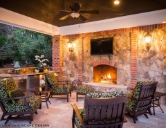 Coogans for a Traditional Patio with a Stone Fireplace and OUTDOOR FIREPLACES by Coogan's Landscape Design