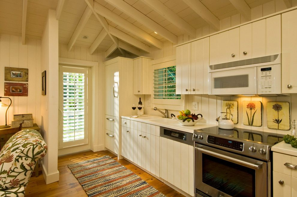 Cookson Doors for a Tropical Kitchen with a Striped Runner and Ldl Interiors Lynn Lombardi Naples Fl by Randall Perry Photography