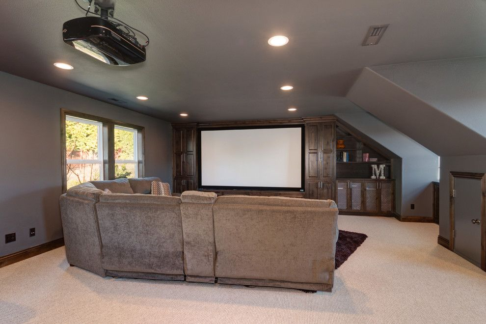Copper Creek Theater for a Rustic Home Theater with a Storage and Organization and Theater Room by Sitka Projects