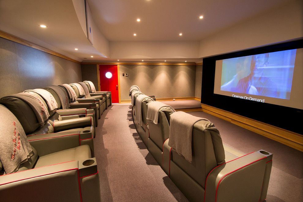 Copper Creek Theater for a Traditional Home Theater with a Red Chairs and Theater Room by Phinney Design Group