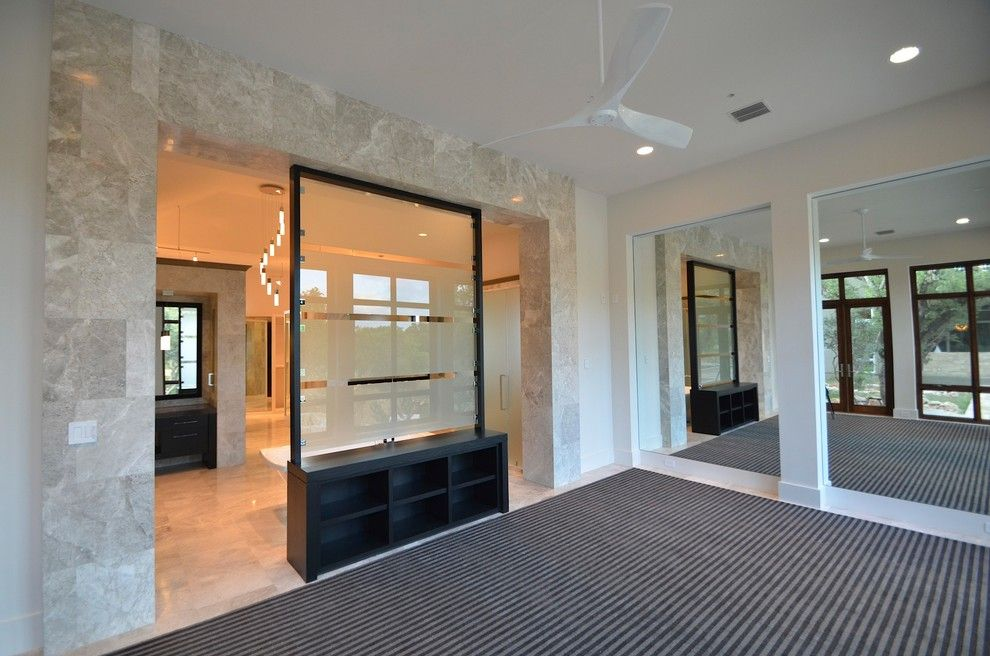 Corepower Yoga Austin for a Contemporary Home Gym with a Contemporary and Transitional Model Home by a Design by Gustavo Arredondo, Inc.