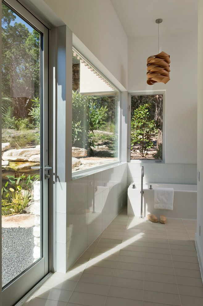 Corepower Yoga Austin for a Modern Bathroom with a Glass Tiles and Austin Modern Home by Foursquare Builders