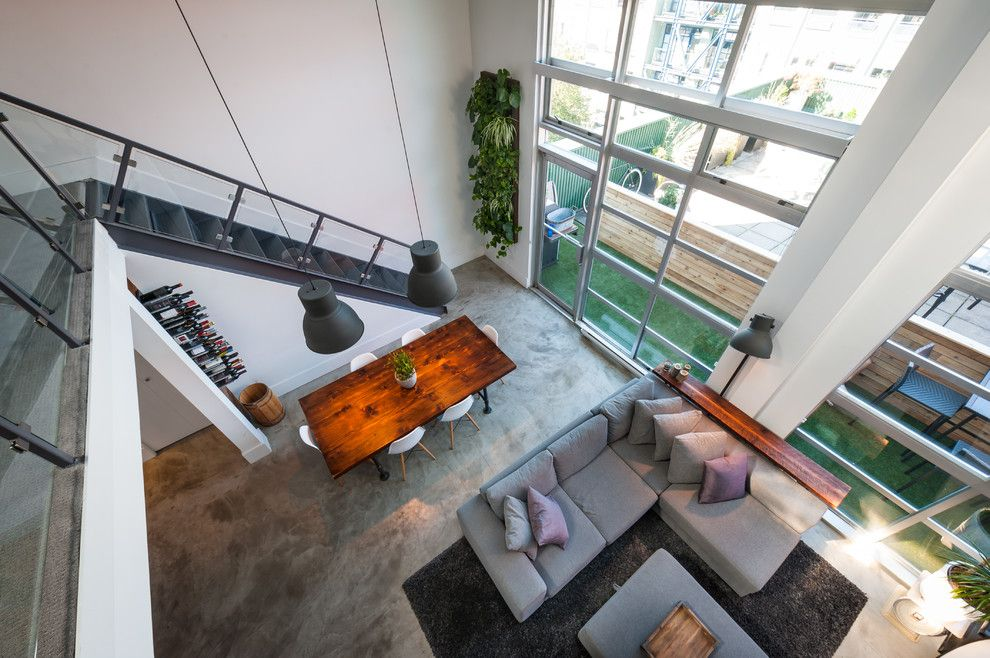 Costco Rug for a Industrial Living Room with a Double Height and Vancouver Loft   Vintage Modern by Themacnabs