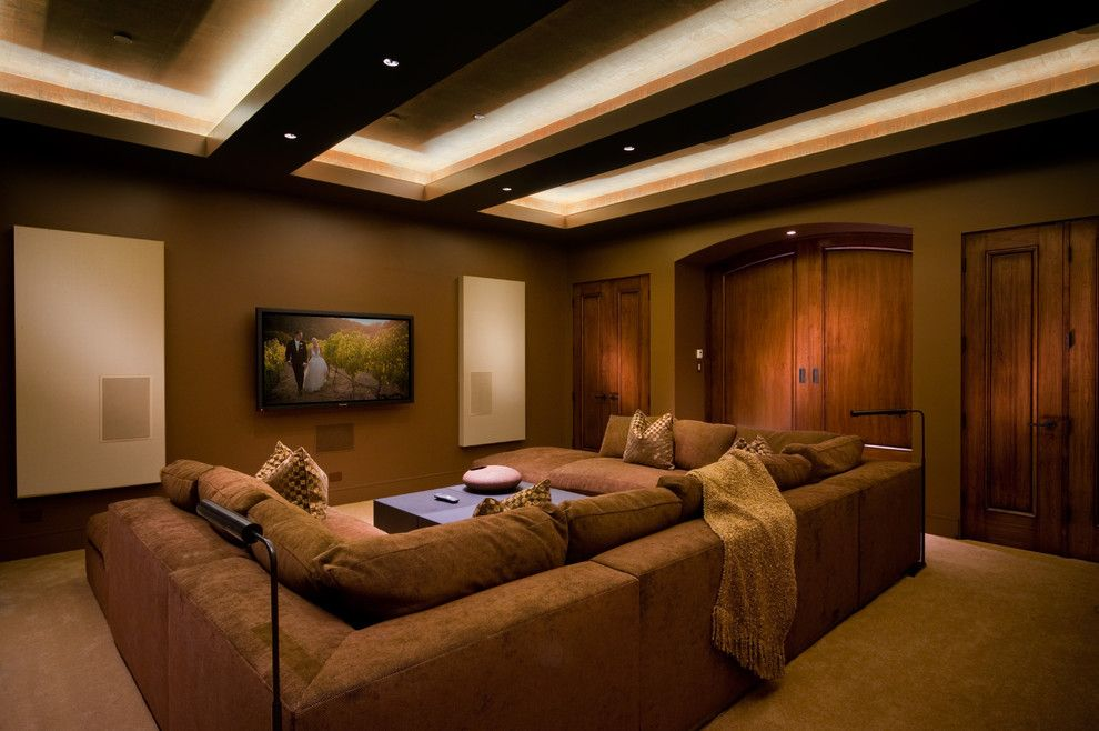 Counch for a Contemporary Home Theater with a Brown Throw Pillow and Pebble Beach Modern by Michelle Pheasant Design, Inc.