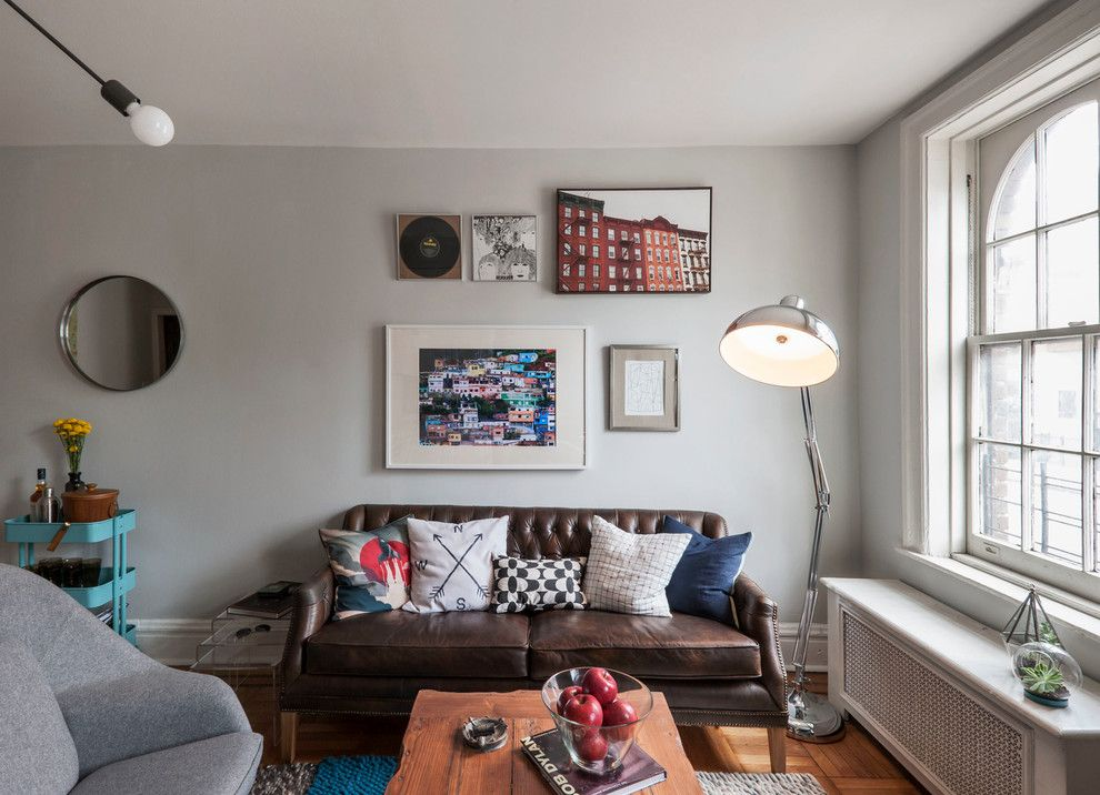 Counch for a Eclectic Living Room with a Gray Walls and West Village Bachelor Pad by Lablstudio