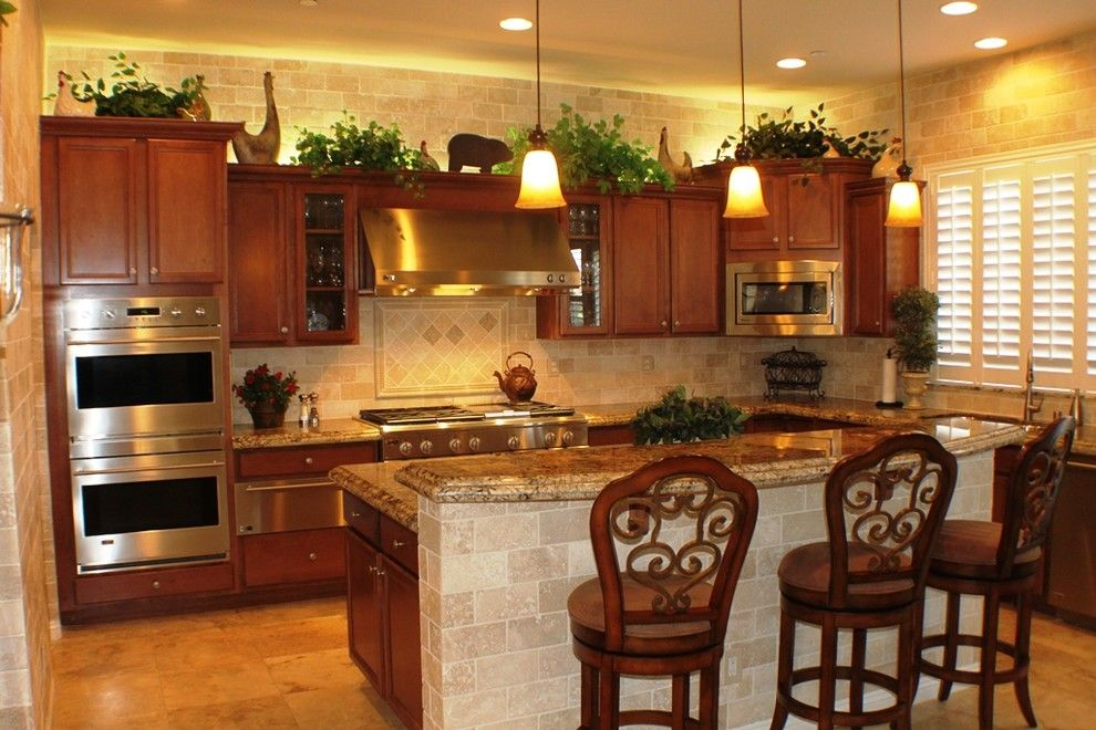 Craigslist Las Vegas Appliances for a Mediterranean Kitchen with a Brown Cabinets and Amber Field by Las Vegas Remodel & Construction