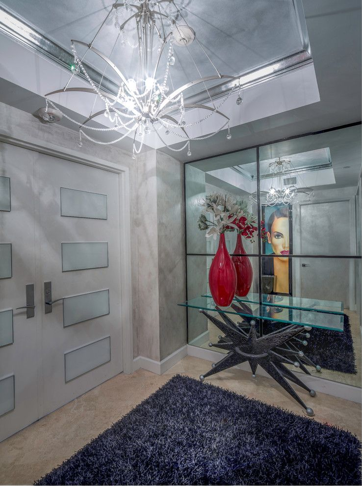 Craigslist South Florida Furniture for a Modern Entry with a Glass Table and Modern Boca Raton Condo by Zelman Style Interiors