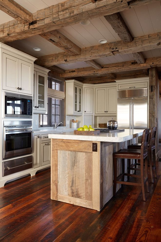 Crawford Electric Supply for a Rustic Kitchen with a Reclaimed Cabinet and Bonde Road Residence by Wellborn + Wright