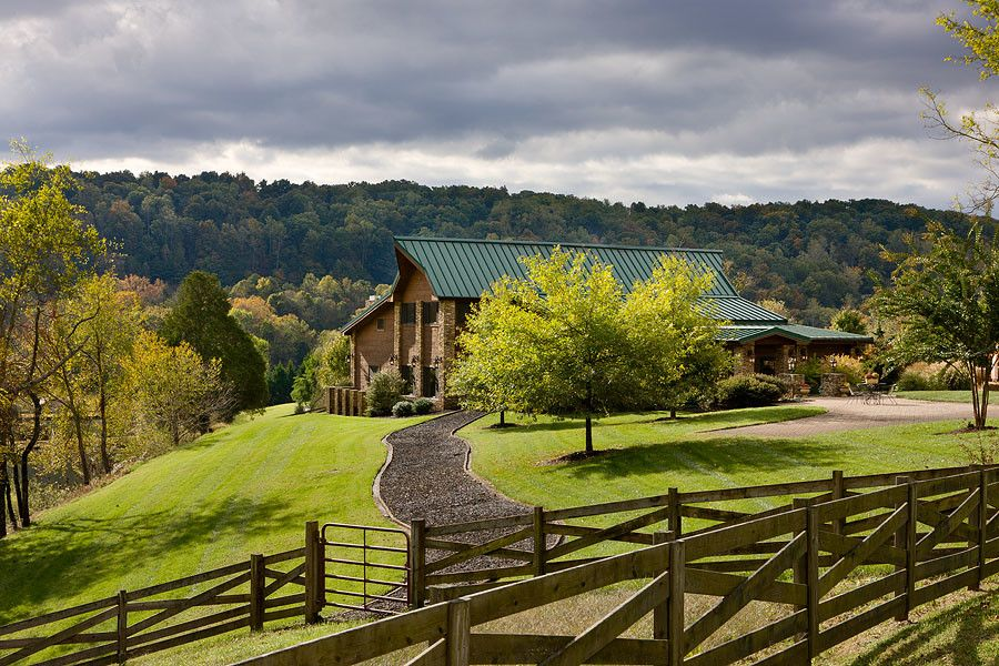 Crazy Horse Nashville for a Rustic Exterior with a Hand Hewn and Repurposed Barn by Appalachian Log and Timber Homes