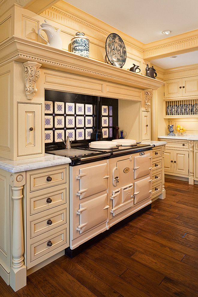 Crescent Springs Hardware for a Traditional Kitchen with a Yellow Cabinets and Cheerful Formality by Superior Woodcraft, Inc.