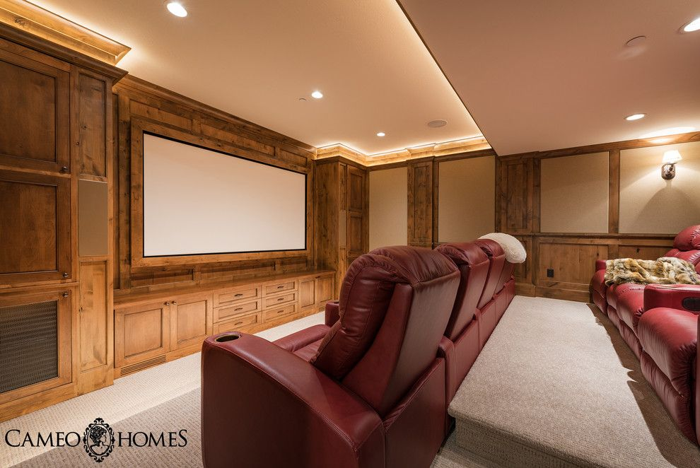 Culver City Theater for a Rustic Home Theater with a Wood Paneling and Luxury Home in Tuhaye, Utah by Park City Home Builder, Cameo Homes Inc. by Cameo Homes Inc.