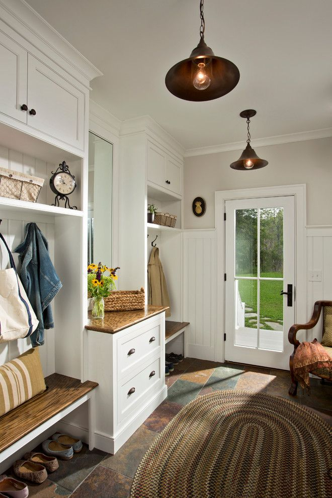 Cumberland Furniture for a Farmhouse Entry with a Backsplash and Farmhouse Vernacular by Teakwood Builders, Inc.