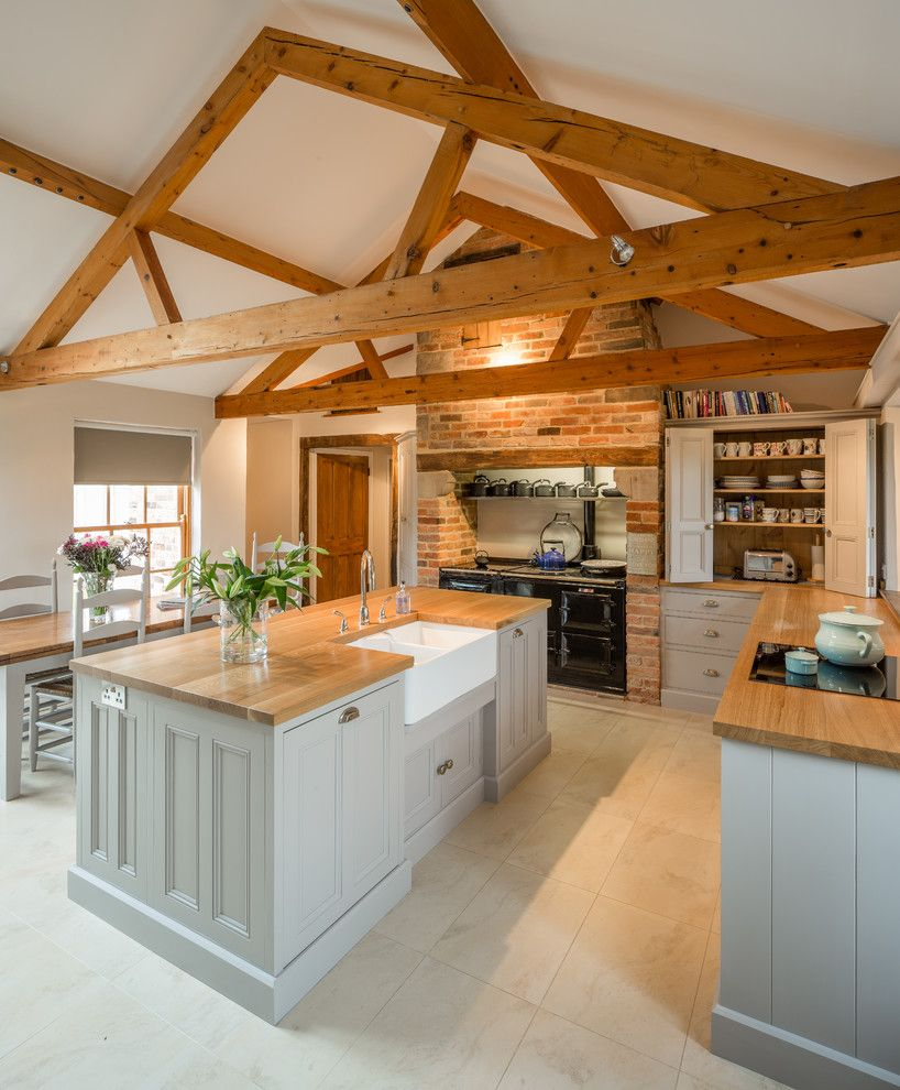 Cupped Hands for a Farmhouse Kitchen with a Aga and Kitchen in Barn Conversion  Rutland, Leicestershire by Hill Farm Furniture Ltd