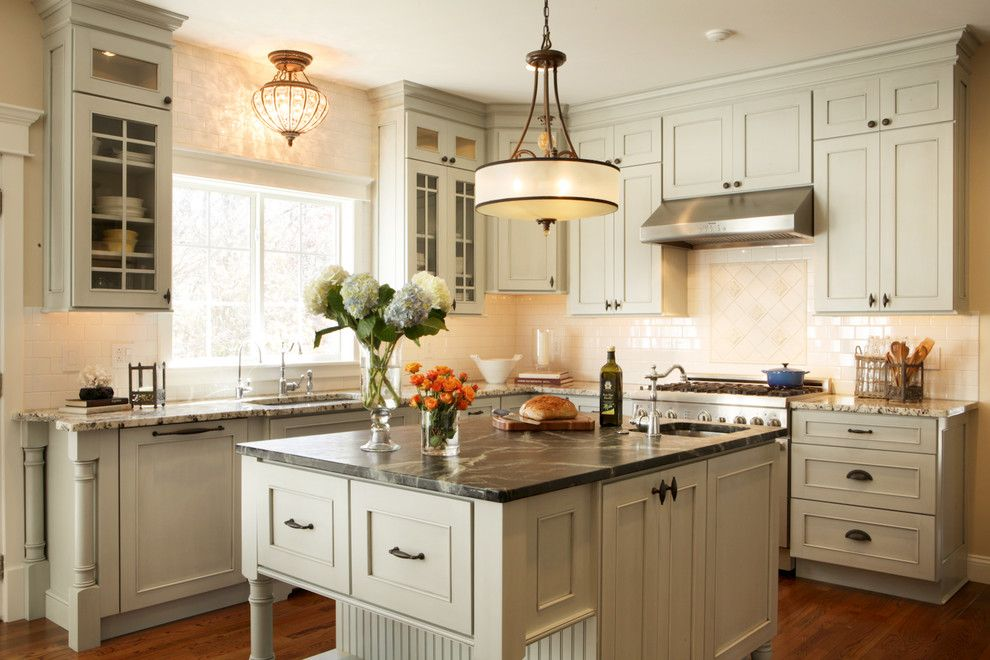 Cupped Hands for a Traditional Kitchen with a Beaded Board and Jenny Rausch by Karr Bick Kitchen and Bath