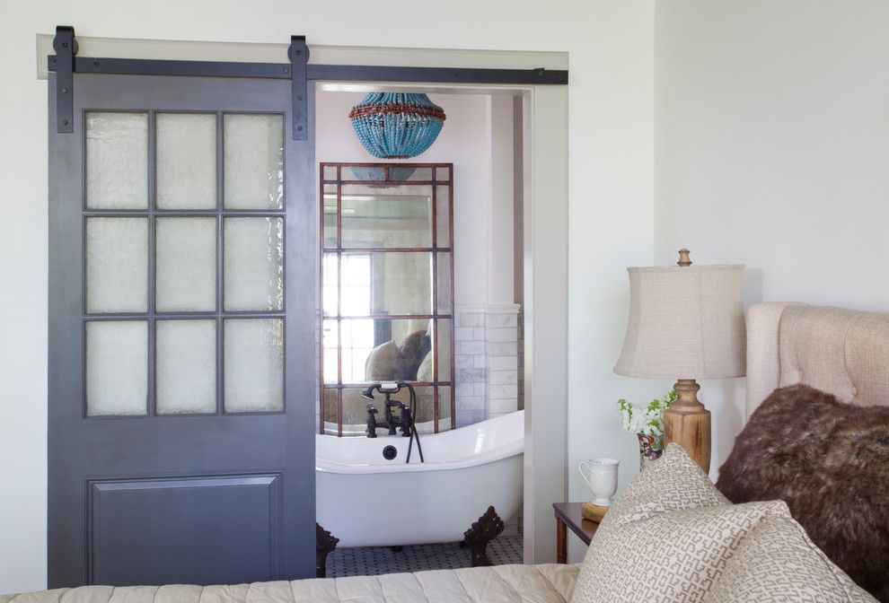 Currey and Co for a Traditional Bedroom with a Antique Mirror and Historic Stanislaus by Couture House Interiors