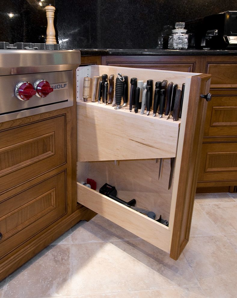Cutco Knife Sharpening for a Traditional Spaces with a Traditional and Mahogany Gourmet Kitchen with White Glazed Center Island by Pridecraft Inc