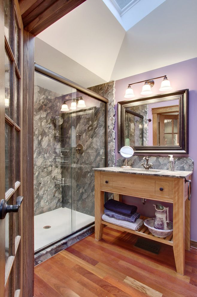 Cutting Edge Granite for a Traditional Bathroom with a Triple Wall Sconce and Picnic Point Remodel by Brook and Company