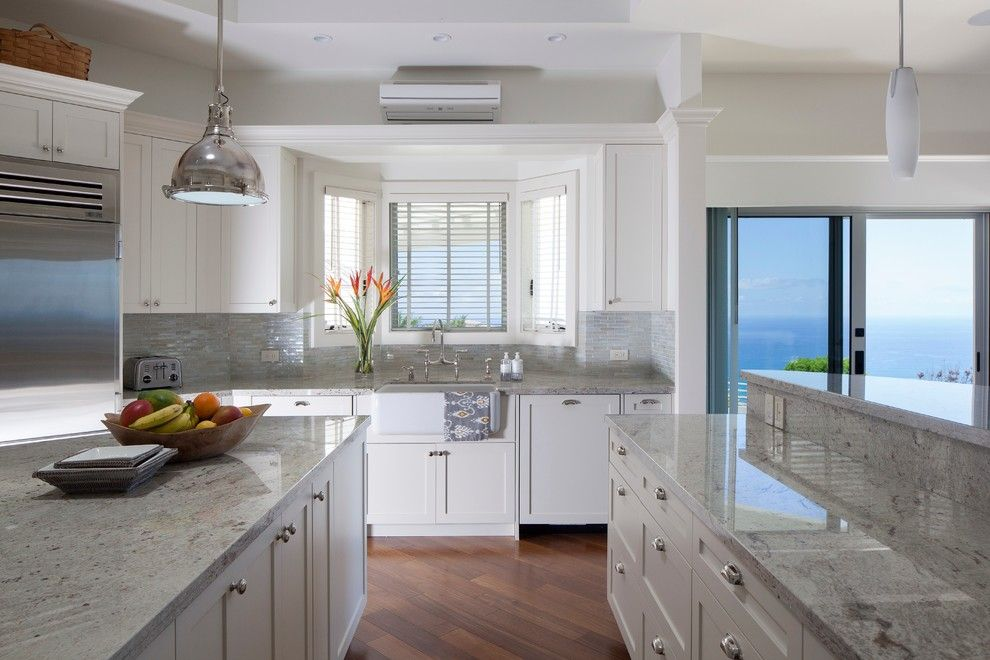 Cutting Edge Granite for a Tropical Kitchen with a Small Tile Backsplash and a Pristine Paradise by Barker Kappelle Construction, Llc