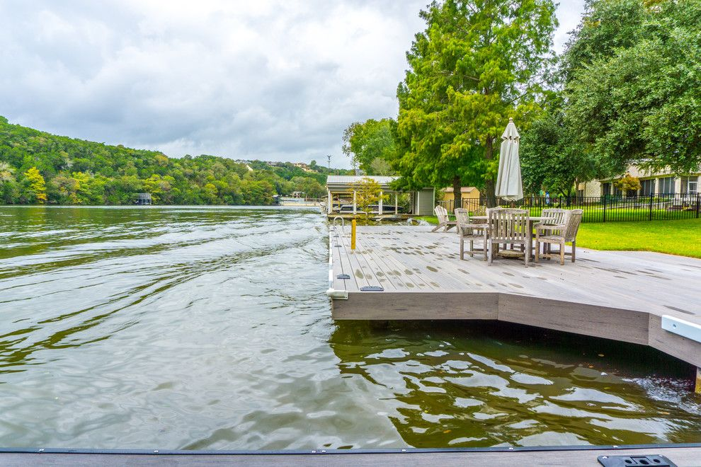 Decks and Docks for a Contemporary Deck with a Gray Boat Slip and Phillips Ranch Dock (Timbertech) by Timbertown