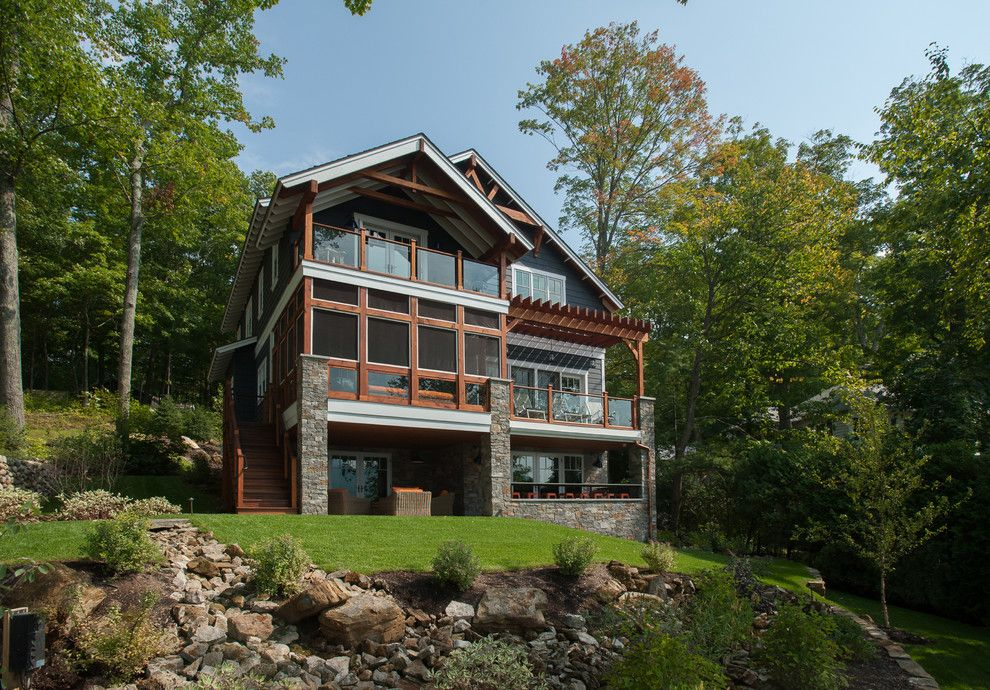 Decks and Docks for a Rustic Exterior with a White Fascia and Lake George Retreat by Phinney Design Group