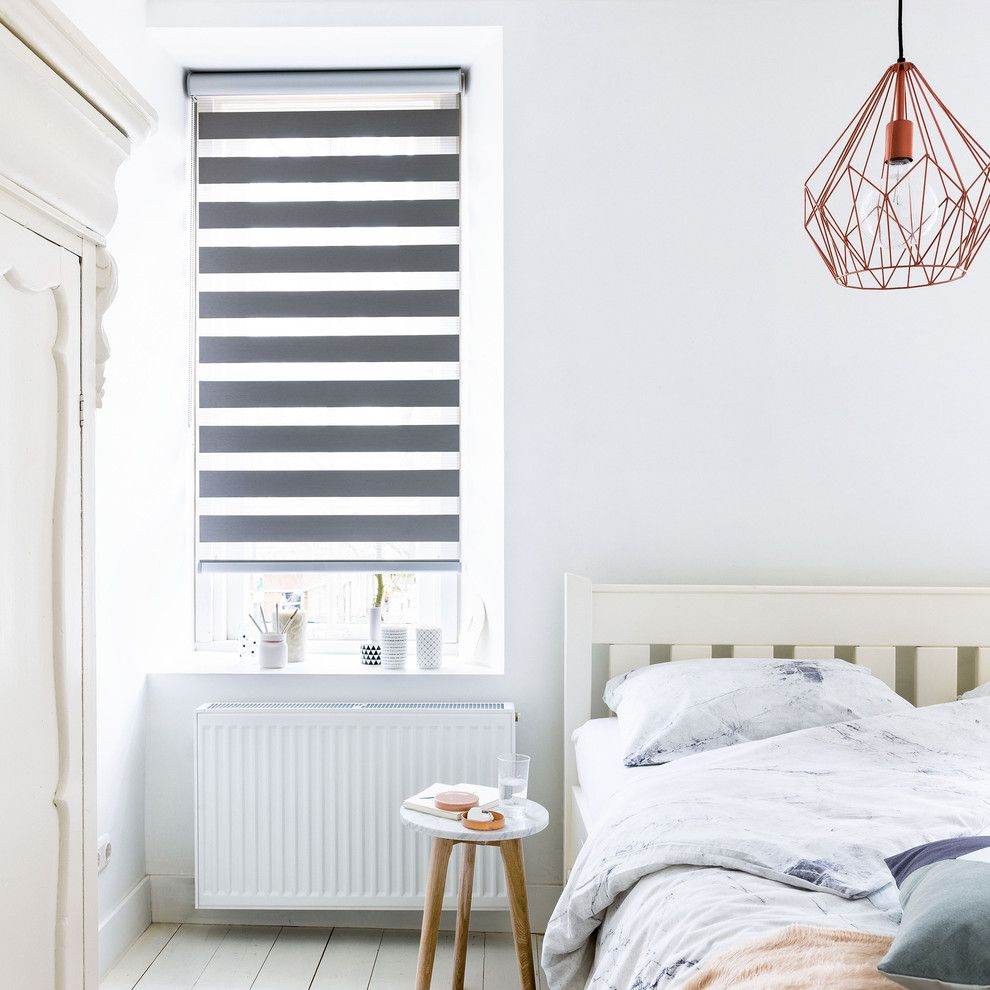 Decluttering Your Home for a Contemporary Bedroom with a Wire Pendant and Budget Blinds by Budget Blinds