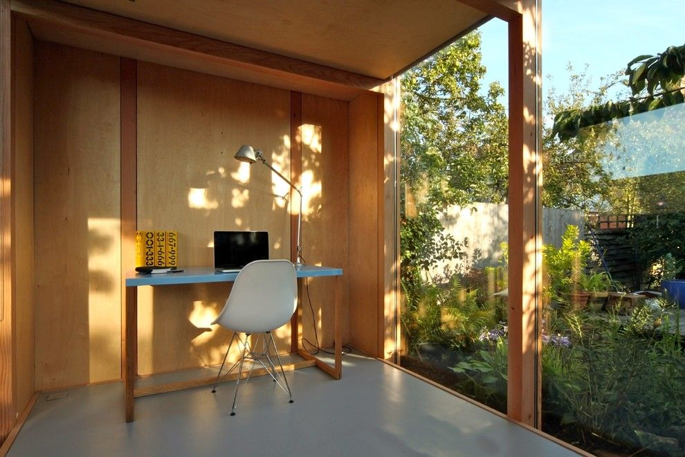 Decluttering Your Home for a Modern Home Office with a Molded Plastic Chair and Garden Room by 3rdspace