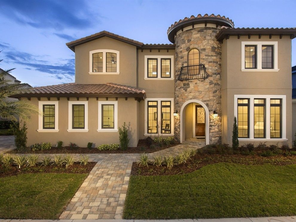 Del Webb Orlando for a Mediterranean Exterior with a Cupolas Roof Turrets and Beautiful Tuscan Villa  in Windermere Florida's, Casa Del Lago by Element Home Builders