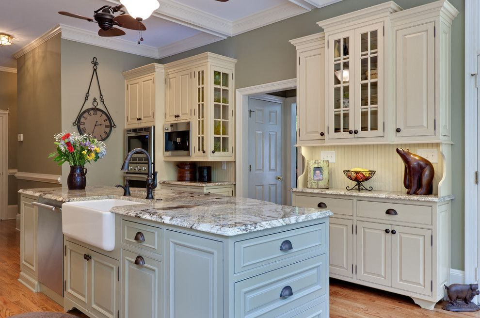 Delta Faucet Warranty for a Traditional Kitchen with a Glass Front Cabinets and Teri Turan by Turan Designs, Inc.