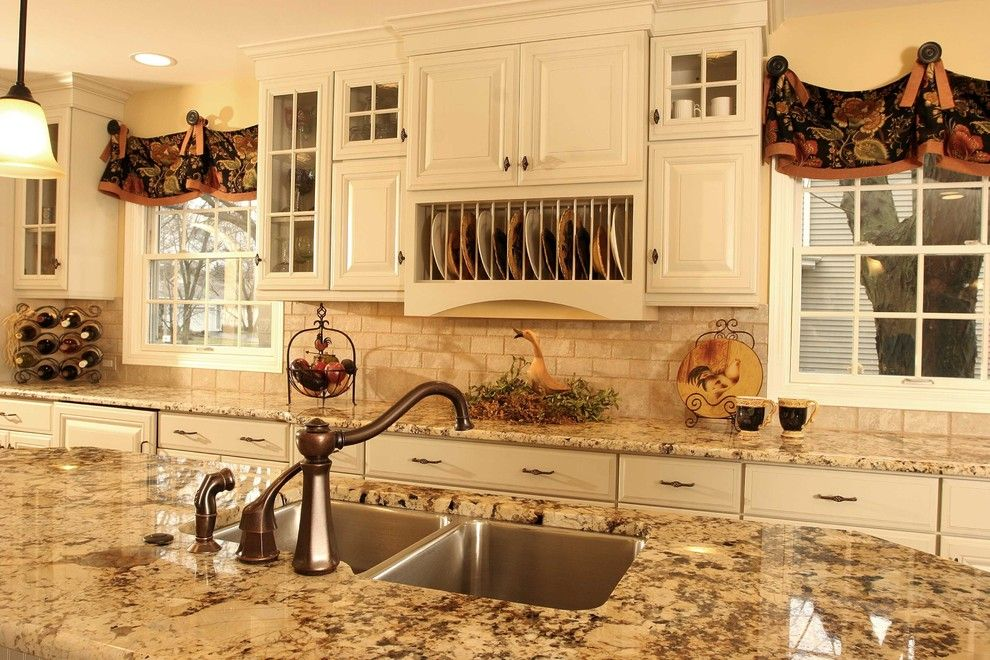 Delta Faucet Warranty for a Traditional Kitchen with a Window Treatments and French Country Kitchen Island by Normandy Remodeling