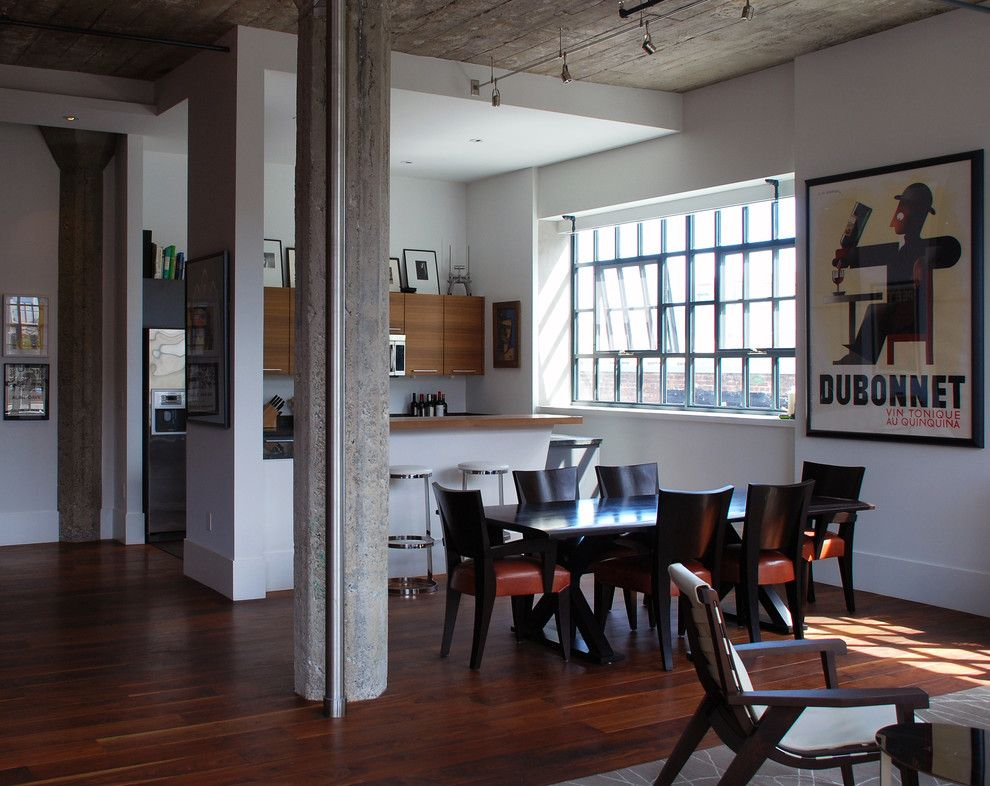 Demising Wall for a Modern Dining Room with a Concrete Columns and South Park Loft by Ccs Architecture