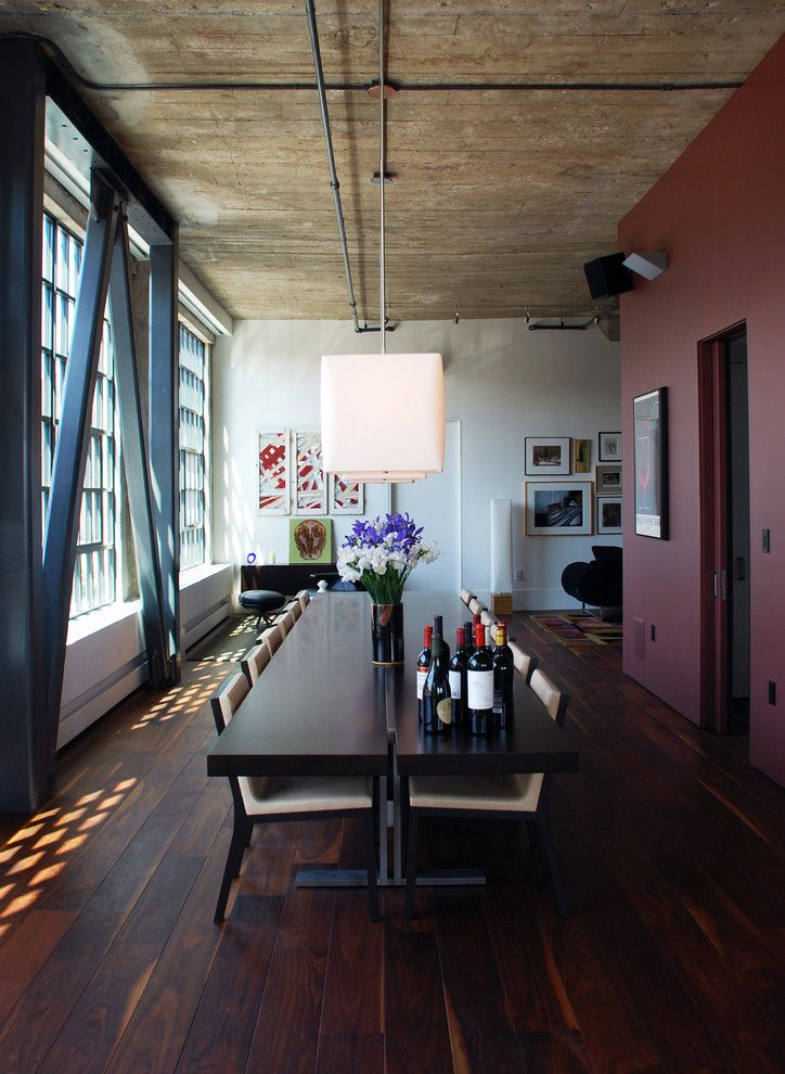 Demising Wall for a Modern Dining Room with a Wood Ceiling and South Park Loft by Ccs Architecture