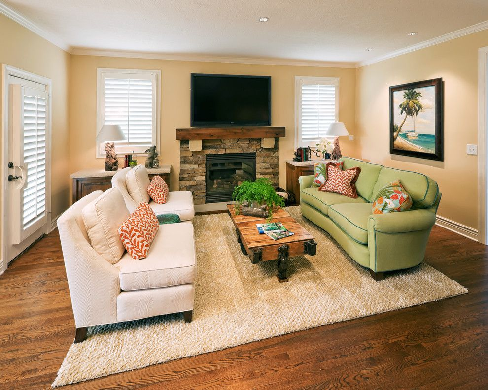 Deseret Digital Media for a Contemporary Living Room with a Green Sofa and Living Room by Becky Berg Design