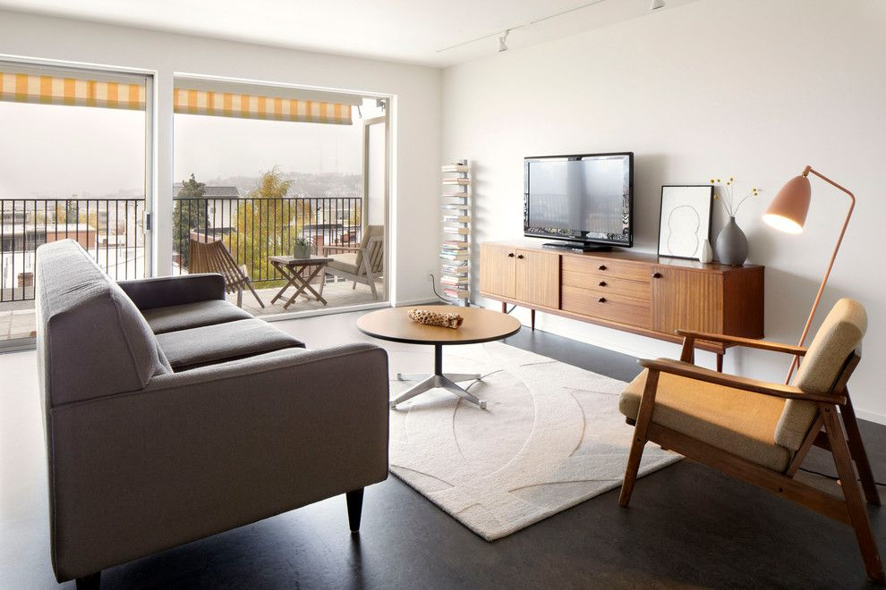 Deseret Digital Media for a Midcentury Living Room with a Dwr and Mid Century Flat Remodel by SHED Architecture & Design