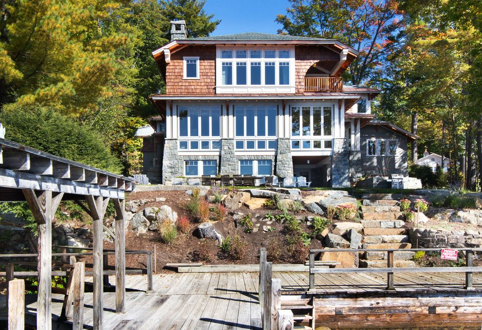Dimensional Shingles for a Rustic Exterior with a Cedar Siding and Great Camp by Phinney Design Group