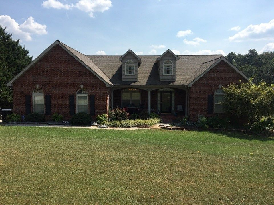 Dimensional Shingles for a  Spaces with a Roof Replacement and Knoxville Residential Roofing by Innovate Roofing & Siding, Inc