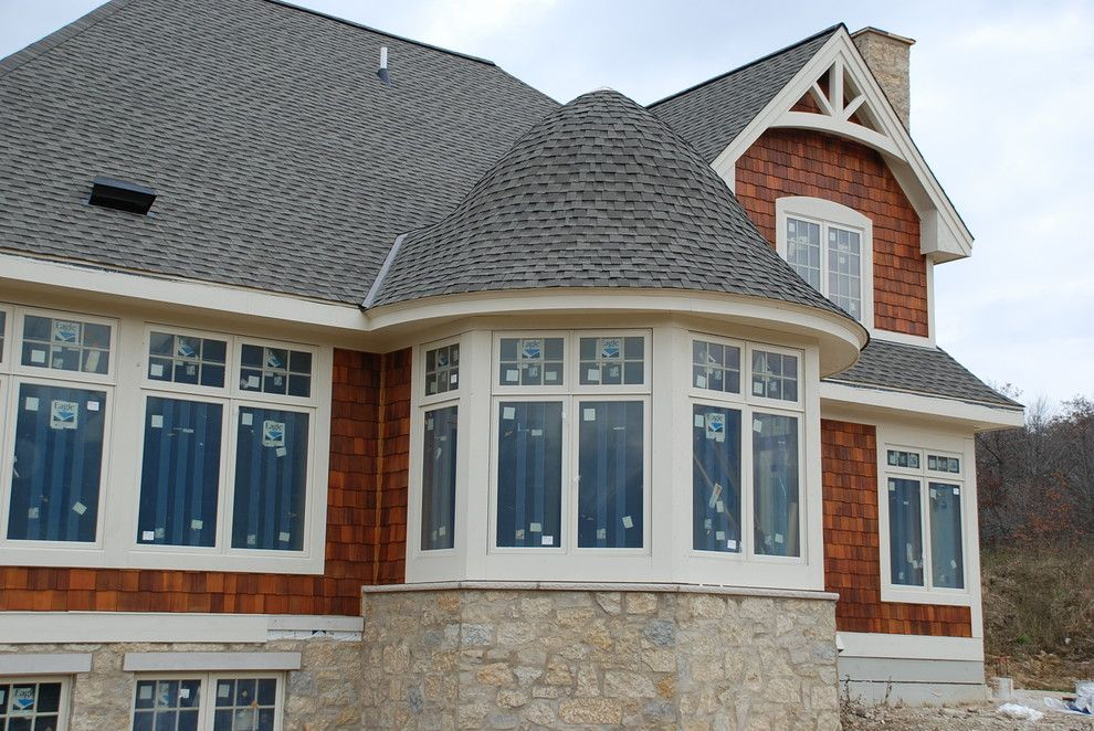 Dimensional Shingles for a Traditional Exterior with a Gaf Timberline and Roofing Projects by L. H. Krueger and Son Inc.