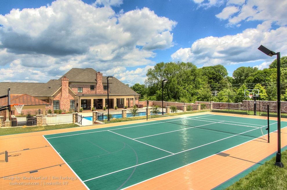 Dimensions of a Basketball Court for a Traditional Exterior with a Pool and Luxurious Outdoor Living Space with Pool by Realtourcast | Tim Furlong Jr.