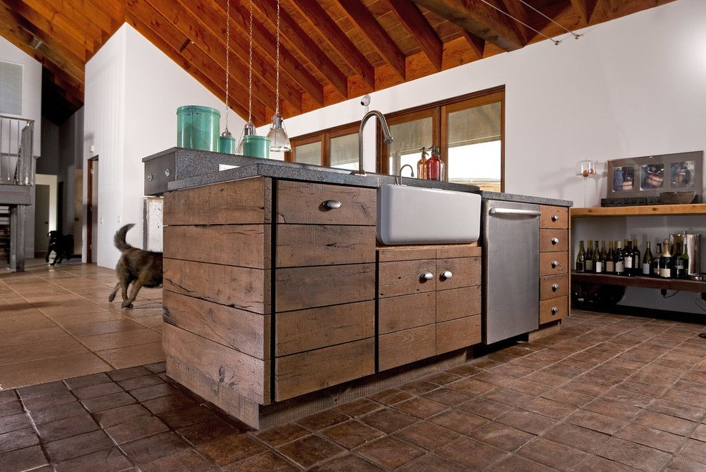 Distressing Furniture for a Industrial Kitchen with a Built in Storage and Esca by Leo Claudio Cabinets