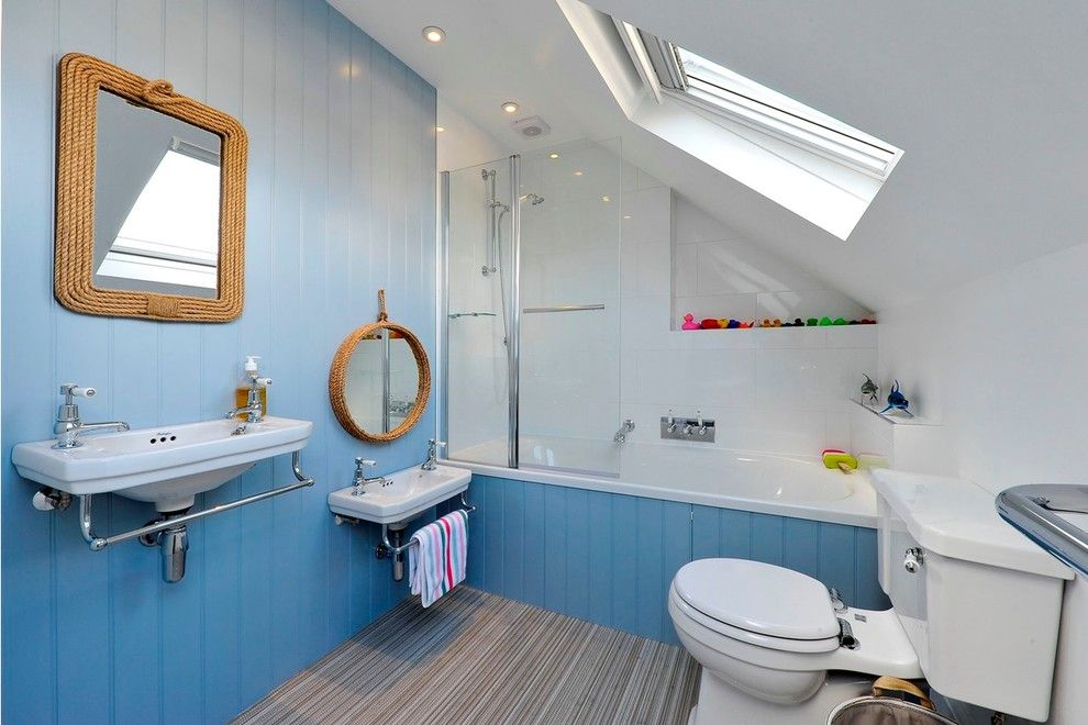 Diy Sunburst Mirror for a Beach Style Bathroom with a Blue Bathroom and Wandsworth. London by Pva Developments