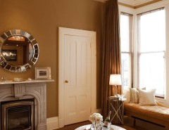 Diy Sunburst Mirror for a Victorian Bedroom with a Sheepskin Rug and Guest Bedroom in Modern Victorian by Adeeni Design Group