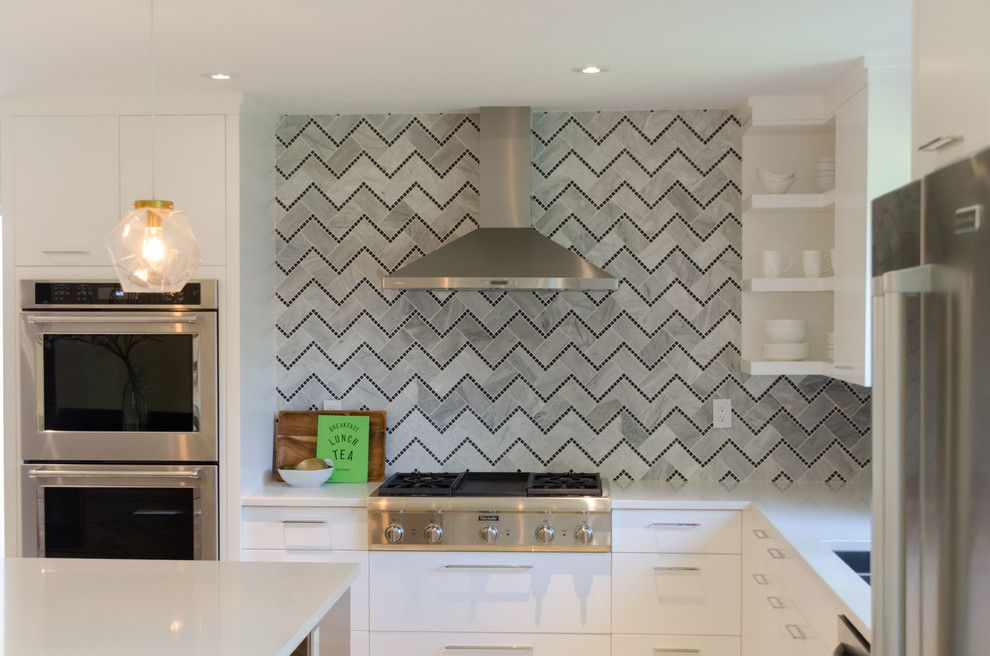 Dlux for a Contemporary Kitchen with a Tile Backsplash and Lindenwoods by Dlux Design & Co.