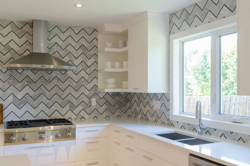 Dlux for a Contemporary Kitchen with a White Quartz and Lindenwoods by Dlux Design & Co.