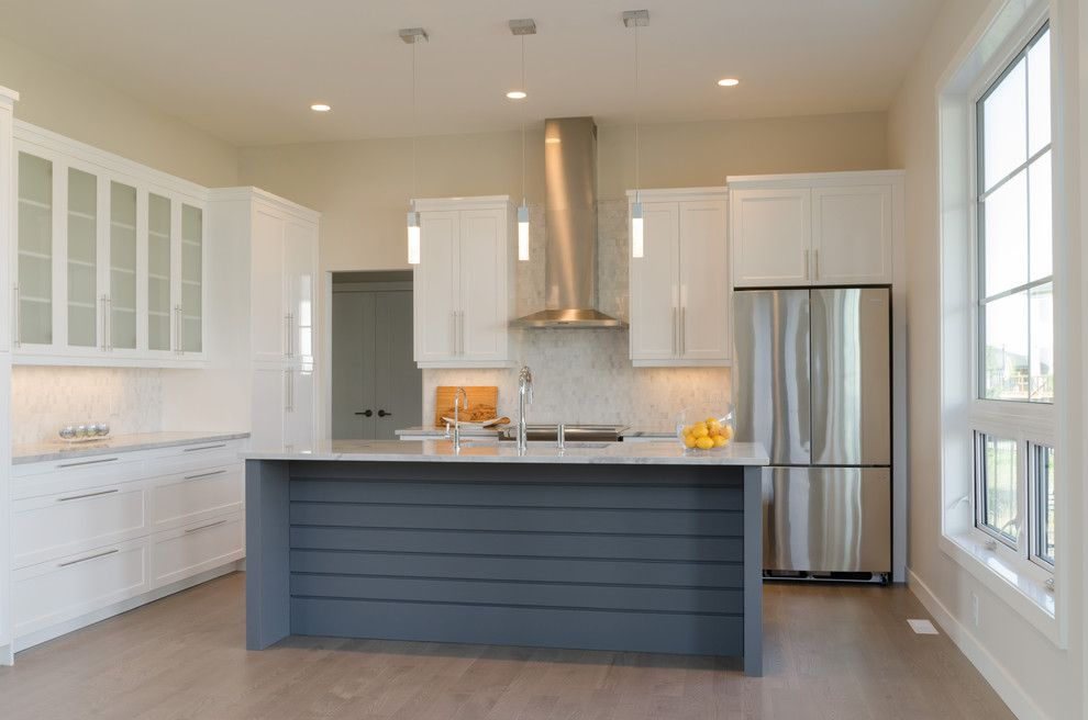 Dlux for a Transitional Kitchen with a Painted Island and Clear Spring by Dlux Design & Co.