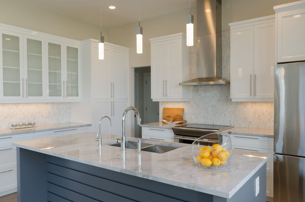 Dlux for a Transitional Kitchen with a Stainless Appliances and Clear Spring by Dlux Design & Co.